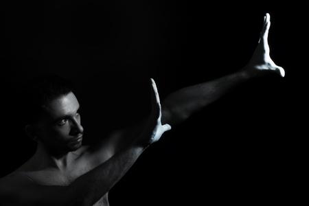 handsome athletic man on black background photo