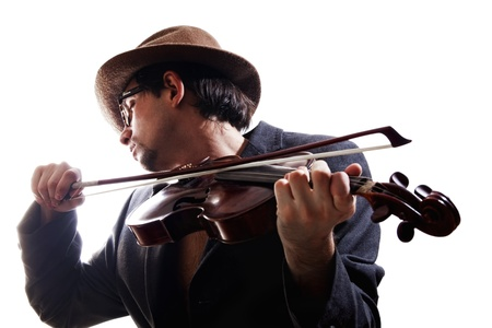 young violinist playing the violin in hat, glasses and jacket isolated on white background