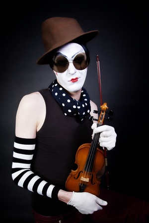 mime with violin and sunglasses on black background Stock Photo - 8691945