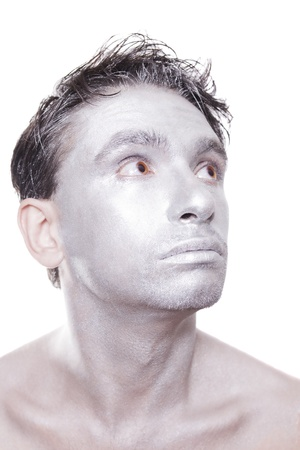 Portrait of young man with  silver makeup isolated on white background photo