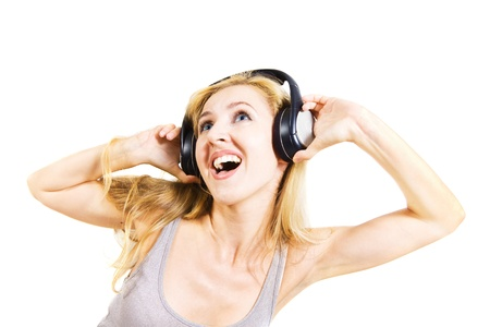young woman singing with headphones isolated on white background Stock Photo - 8691979