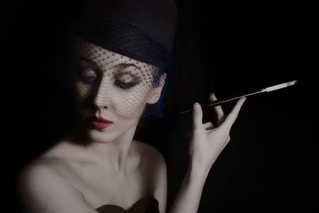 Retro portrait of beautiful young caucasian woman in veil with cigarette Stock Photo - 8712283