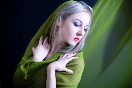 silk scarf: Gentle studio portrait of  beautiful young woman in green summer dress Stock Photo