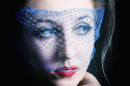 Portrait of a young beautiful blue-eyed women in veils close�� Stock Photo - 8712451