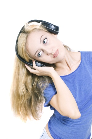 young woman with headphones isolated on white background Stock Photo - 8810461
