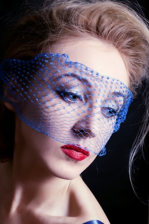 Portrait of a young beautiful blue-eyed women in veils closeac Stock Photo - 8810494