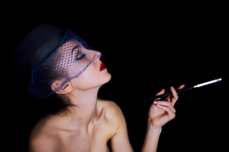 Retro portrait of beautiful young caucasian woman in veil with cigarette Stock Photo - 8810564