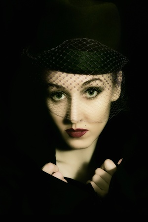 Portrait of young beautiful caucasian woman in veil on black background close up Stock Photo - 8810612