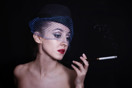 Retro portrait of beautiful young caucasian woman in veil with cigarette Stock Photo - 8905153