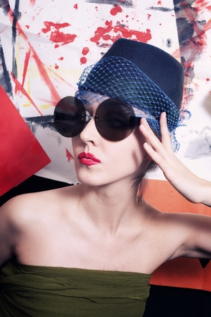 Portrait of beautiful young women in veils and round sunglasses on a colorful background photo