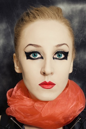 Portrait of beautiful young woman with bright makeup photo