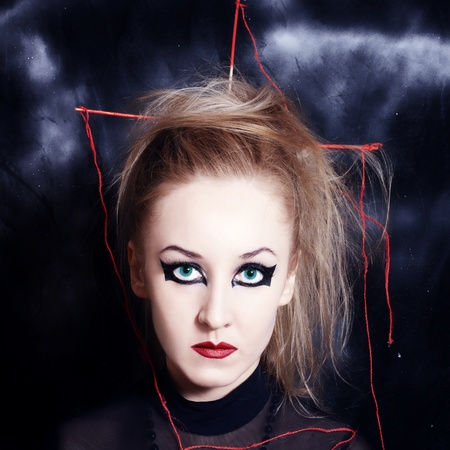 Portrait of beautiful young woman with bright Gothic makeup closeup photo