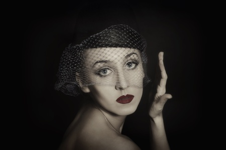Retro portrait of beautiful young woman in veil Stock Photo - 8999020