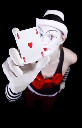 Mime in white hat showing ace of hearts closeup photo