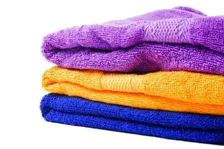 purple, yellow and blue towel isolated on white background photo