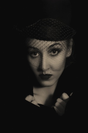 Portrait of young beautiful caucasian woman in veil on black background close up. vintage Stock Photo - 9227678