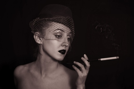 vintage Retro portrait of beautiful young caucasian woman in veil with cigarette closeup Stock Photo - 9227682
