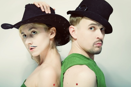 Double studio portrait of a man and a woman with a theatrical makeup closeup photo