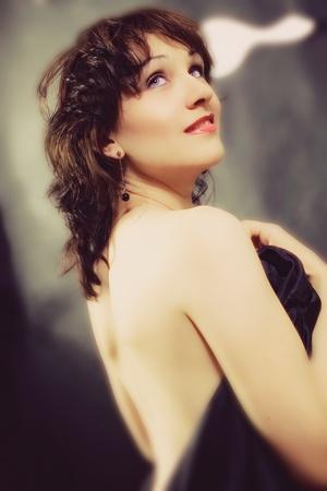 Studio portrait of a young brunette woman closeup photo
