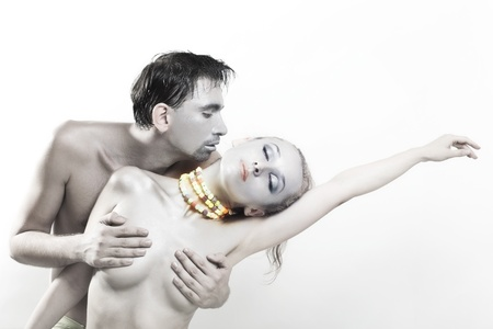artistic nude: Dancing naked man and woman on a white background