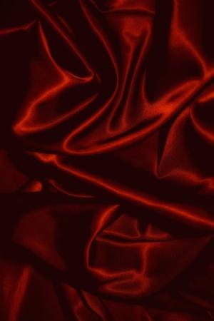 textuur van een zwarte silkcloth rood satijn zijde close up Stockfoto