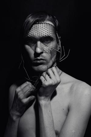 Portrait of a young handsome man closeup photo