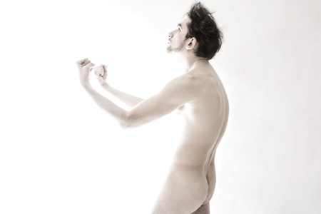 Studio portrait of handsome young man standing nude on white background Stock Photo - 10026203