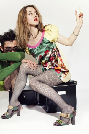 stockings feet: young girl with a cigarette an gay in sunglasses