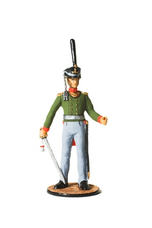 Tin Soldier. Russian hussar in uniform with a sword of the War of 1812