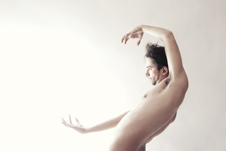 Young beautiful naked man dancing on a white background Stock Photo - 10119504