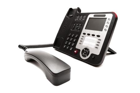 telephone headsets: Primer tel�fono negro sobre fondo blanco