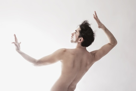Young beautiful ������ naked man dancing on white background Stock Photo - 10263810