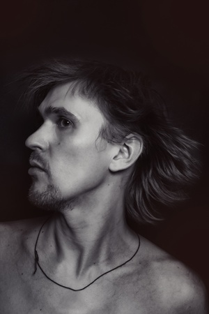 Beautiful face of a young man close up photo
