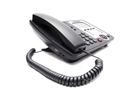 telecommunications equipment: black IP phone closeup on white background