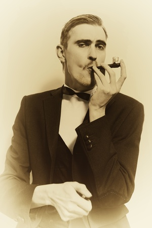 1 man only: retro portrait of adult man smoking pipe closeup