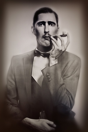 retro portrait of an adult man smoking a pipe closeup photo