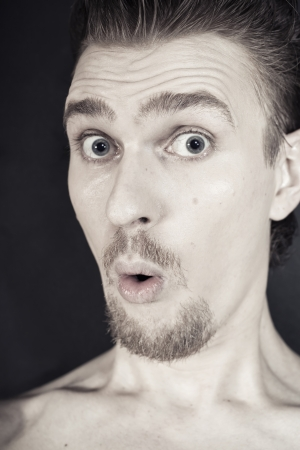 profile of man with funny face closeup photo