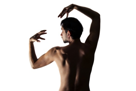 nude ass: Young beautiful naked man dancing on white background