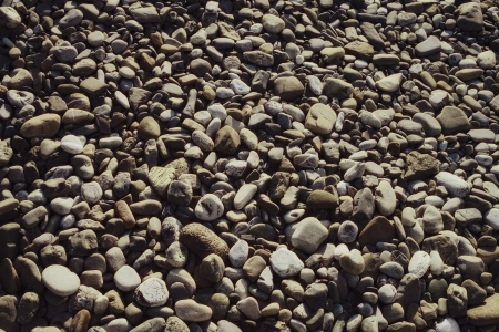Surface covered with gray stones rounded pebbles closeup  photo