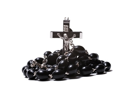 Catholic rosary with a crucifix isolated on white background closeup photo