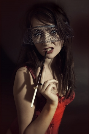 Young woman in a veil of cigarette. Retro style photo