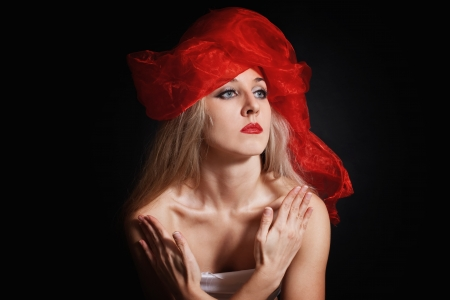 Portrait of a young woman in a red headdress on a black background Stock Photo - 14718399