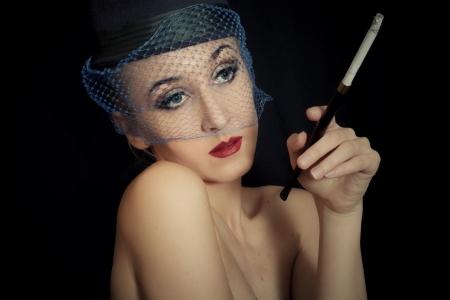 vintage Retro portrait of beautiful young caucasian woman in veil with cigarette closeup  photo