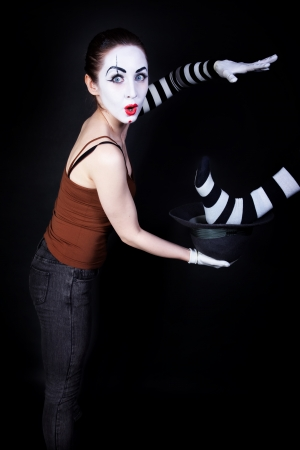 Woman mime performing focus on a black background photo