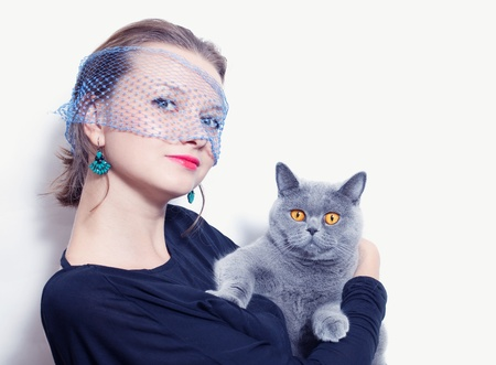 young woman in a veil holding gray British cat Stock Photo - 15517835