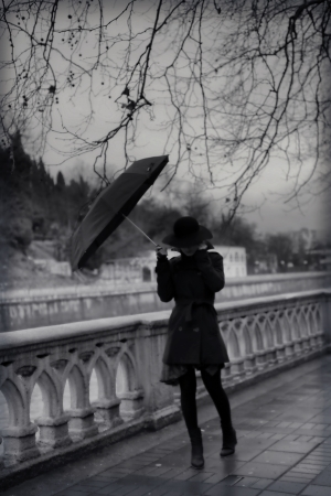 umbrella rain: Young woman in coat with umbrella