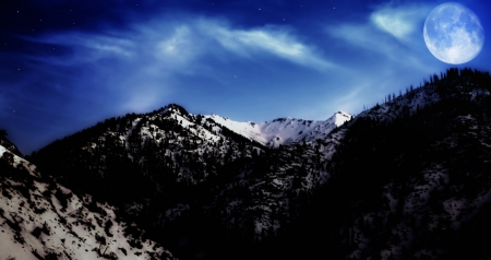 Night winter mountain winter landscape with yellow moon and stars photo