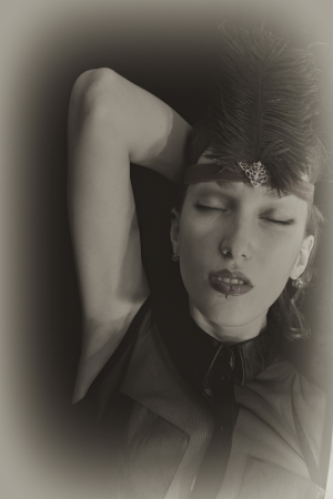 Portrait of a cabaret dancer wearing a headdress with a feather close up photo