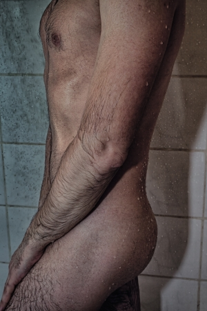 wet body of a young man in the shower photo