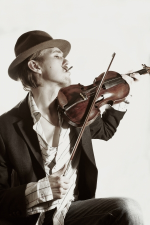 young violinist playing to violin close up photo